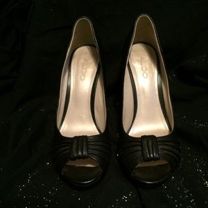 Aldo black high heels size 38, which is a size 7US